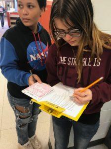 Two students processing radon test kits
