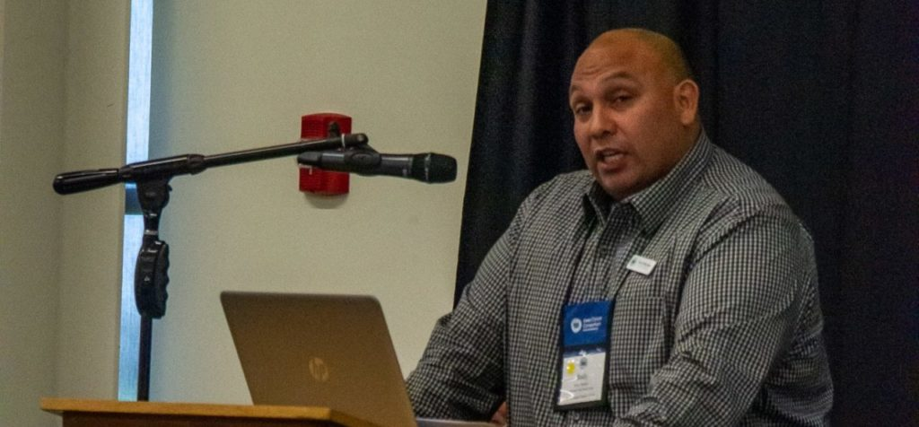 Board member speaking at the Iowa Cancer Summit microphone