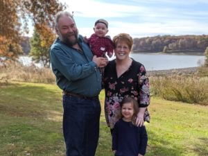 Board Treasurer Kevin Kelly, his wife Cheryl, and two granddaughters.